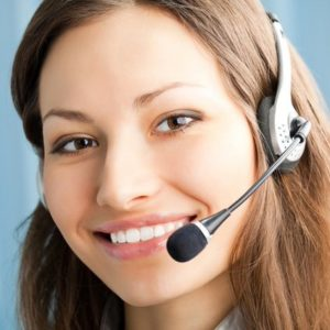 Portrait of happy smiling support phone operator in headset at workplace. To provide maximum quality, I have made this image by combination of two photos. You c